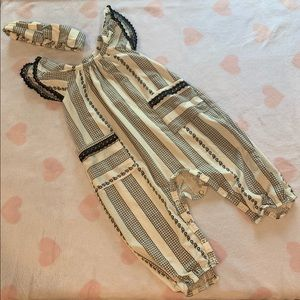 Black and white jumpsuit with matching headband.